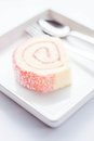 Sweet dish of pink jam roll cake stock photo Royalty Free Stock Photo