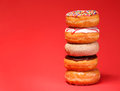 Sweet donuts on red Royalty Free Stock Photo