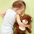 Sweet dreams child sleeping with teddy bear Stock Photo