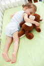 Sweet dreams child sleeping with teddy bear Stock Photography