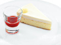 Sweet fresh tasty cheesecake slice with red berries topping on a round plate Stock Photo