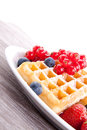 Sweet fresh tasty waffles with mixed fruits  Stock Images