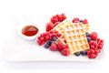 Sweet fresh tasty waffles with mixed fruits  Stock Photo