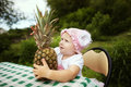 Sweet funny girl with pineapple little outdoors Stock Photo