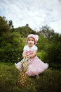 Sweet funny girl with pineapple little outdoors Royalty Free Stock Images
