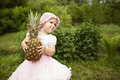Sweet funny girl with pineapple little outdoors Stock Photos