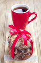 Sweet gingerbread and cup of tea christmas tied with red ribbon Stock Image