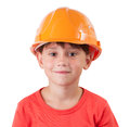 Sweet girl in a building helmet Stock Photos