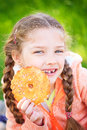 Sweet girl with a fallen tooth holding cookies in her hand Royalty Free Stock Photo