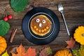 Sweet Halloween food, pumpkin pancakes for kids Royalty Free Stock Photo