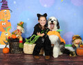 Sweet halloween photo of little girl and her puppy yawning Royalty Free Stock Photos