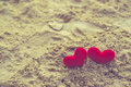 Sweet heart on sand beach under sunset and warm light. abstract background love summer on the beach. vintage color Royalty Free Stock Photo
