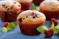 Sweet homemade raspberry muffins on wooden table. Royalty Free Stock Photo