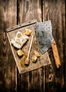 Sweet honey in the comb with an old hatchet. Royalty Free Stock Photo