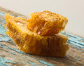 Sweet honey in the comb . On rural wooden background. Glass bank with honey