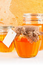Sweet honey in glass jars Stock Photos