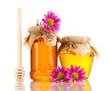 Sweet honey in jars with drizzler Royalty Free Stock Photo