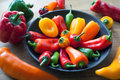Sweet and hot peppers in a kitchen bowl mix of chilli on chopping board Stock Images