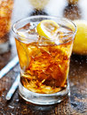 Sweet iced tea with rain mist coming down shot selective focus Royalty Free Stock Image