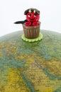 Sweet incubus at an old globe bonbon shaped like Stock Photography