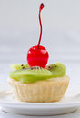 Sweet kiwi and cherry fruity tart Stock Photography