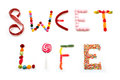Sweet life words made of candies on white background Royalty Free Stock Image