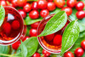 Sweet liqueur made from ripe cornelian cherry and alcohol Royalty Free Stock Photo