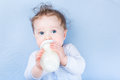 Sweet little baby drinking milk in bottle Royalty Free Stock Photo