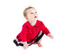 Sweet little baby girl in a red dress learning to crawl isolated on white Royalty Free Stock Image