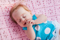 Sweet little baby sleeping she in blue dress with white polka dots Royalty Free Stock Images