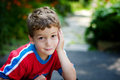 Sweet little boy adorable looking at the camera with a shy smile and big brown eyes Royalty Free Stock Images