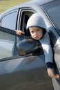 Sweet little boy looking out from the car seriously of open door of Royalty Free Stock Photography