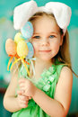 Sweet little girl dressed in easter bunny ears portrait of a cute holding colorfull eggs Stock Photo
