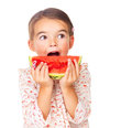 Sweet little girl eating a slice of watermelon Royalty Free Stock Image