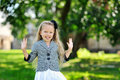 Sweet little girl having fun in a park Royalty Free Stock Photo