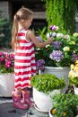 Sweet little girl holding a bouquet of tulips in the yard this image has attached release Stock Image