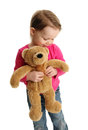 Sweet little girl holding a teddy bear toddler looking down Royalty Free Stock Image