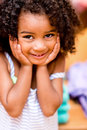 Sweet little girl portrait of a looking shy and smiling Royalty Free Stock Photo
