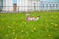 Sweet little girl relaxing on the grass Royalty Free Stock Photo