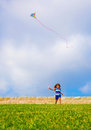 Sweet little girl running with kite on green field adorable child having fun on backyard playing game windy paper toy Stock Photography