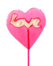 Sweet lollipop in the shape of a heart Royalty Free Stock Images
