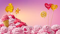 Sweet magical landscape of ice cream and candy on a pink background Stock Photo