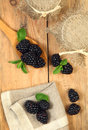 Sweet meal blackberry on wooden table Royalty Free Stock Images