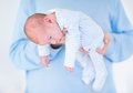 Sweet newborn baby sleeping in his father's arms Royalty Free Stock Photo