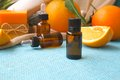 Sweet orange essential oil a dropper bottle of oranges in the background Royalty Free Stock Photo