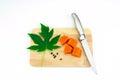Sweet papaya slice on chopping bord isolated white background Stock Image