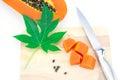 Sweet papaya slice on chopping bord isolated white background Royalty Free Stock Photos