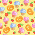 Sweet pattern cakes on yellow background. Seamless.