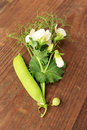 Sweet pea flowers and pod on wooden table Royalty Free Stock Photo