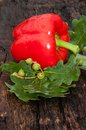 Sweet pepper red on the old wooden table top Royalty Free Stock Photo